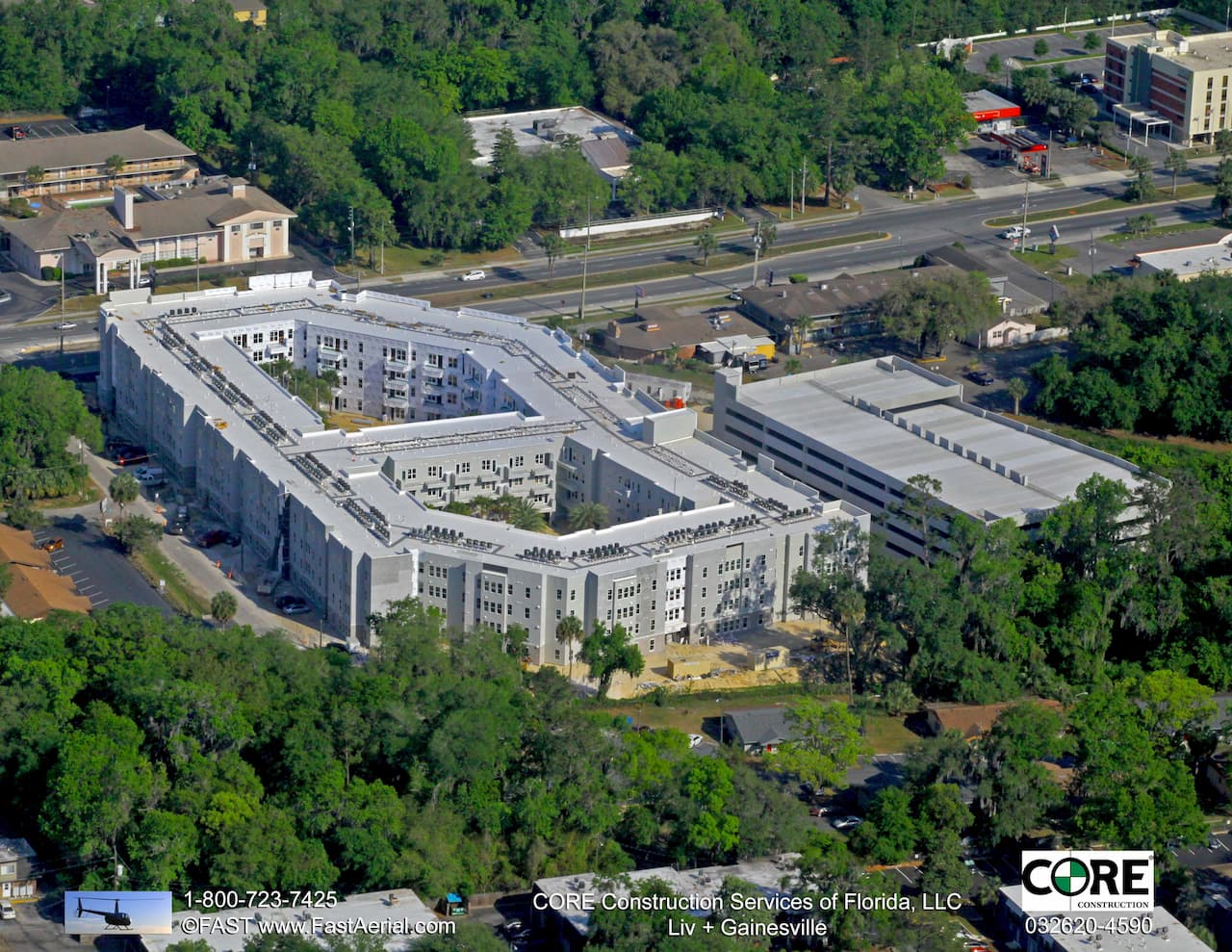 Aerial View of Liv+ Gainesville Apartments With Trees Surrounding It