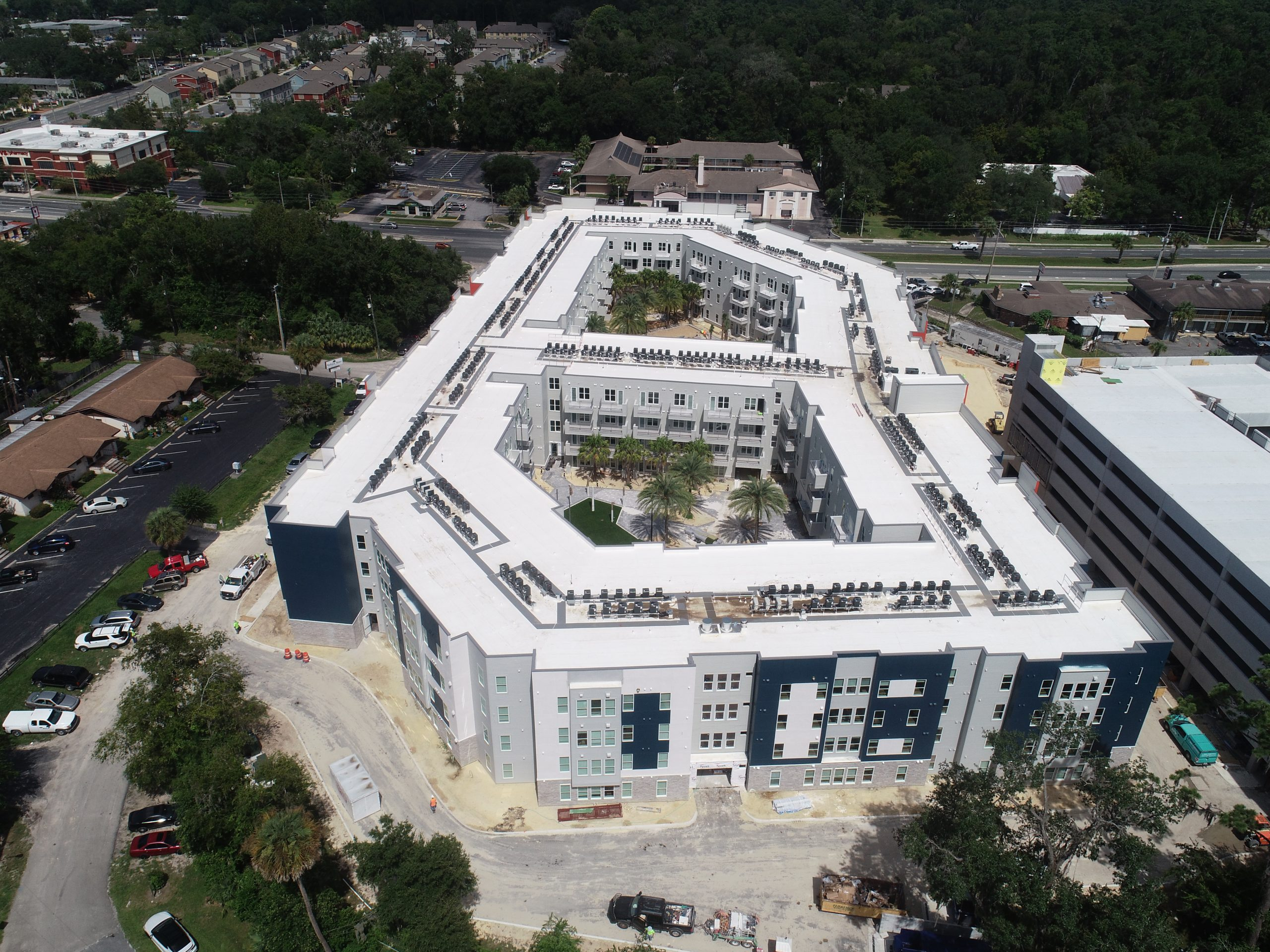 Aerial View of LIV+ Gainesville Apartments With Trees In The Center