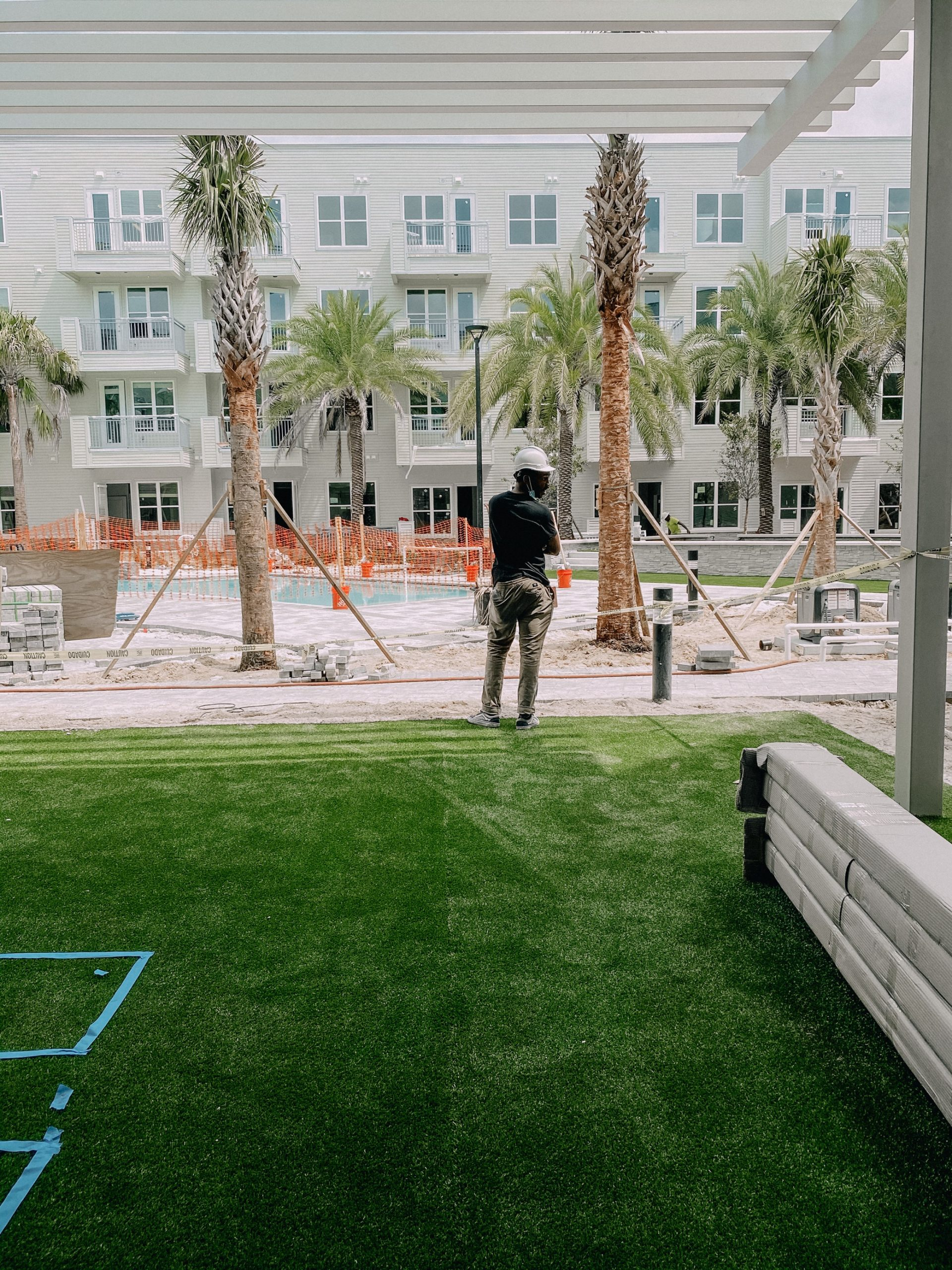 Courtyard at Liv+ Gainesville Apartments With a Construction Worker in the Background